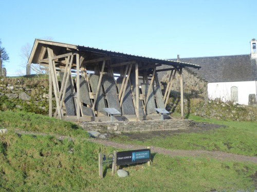 Slabs with completed facing walls and interpretation boards